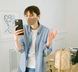 Woman having video call on smartphone