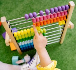 Child playing with an abacus and learning to count